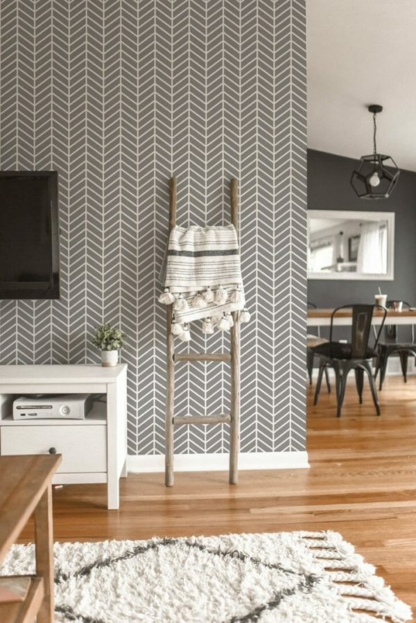 Herringbone wallpaper in gray and white on the accent wall