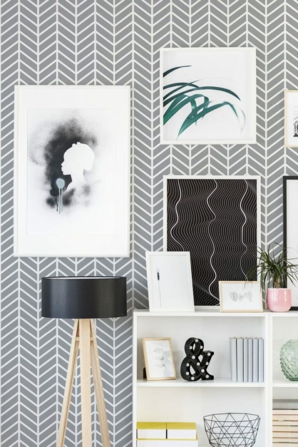 Gray and white herringbone oattern wallpaper with wall art