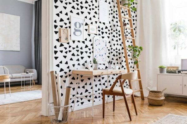 Black and white scattered triangles design pattern