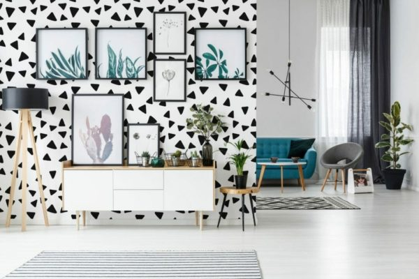 Black and white scattered triangles peel and stick wallpaper