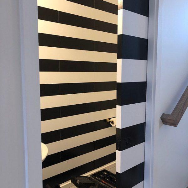 Black and white stripe wallpaper used in bathroom