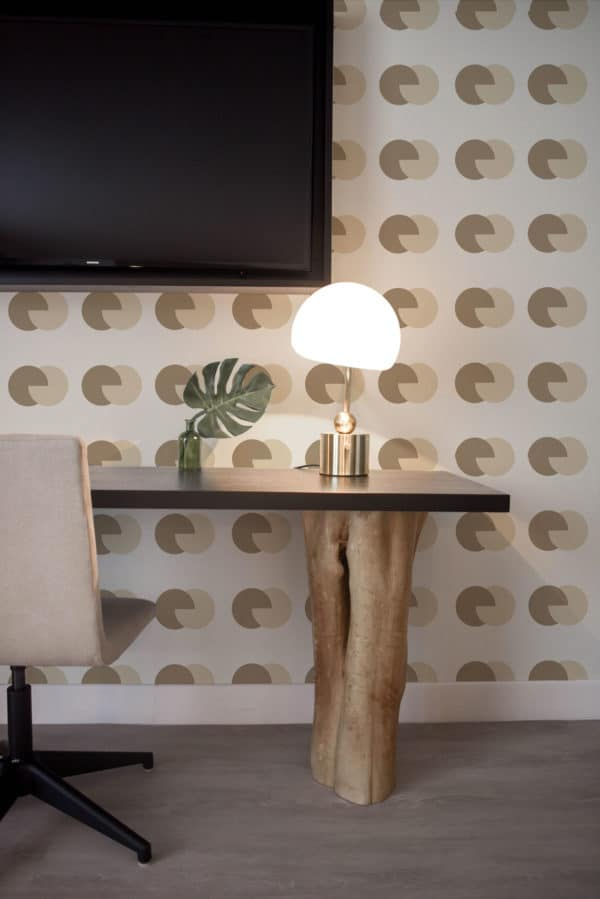 brown and beige circular wallpaper roll