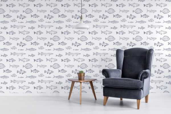 fish wallpaper on wall behind chair