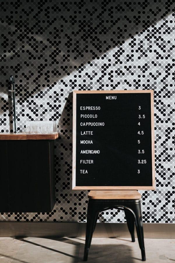 black monochrome polka dots peel and stick wallpaper