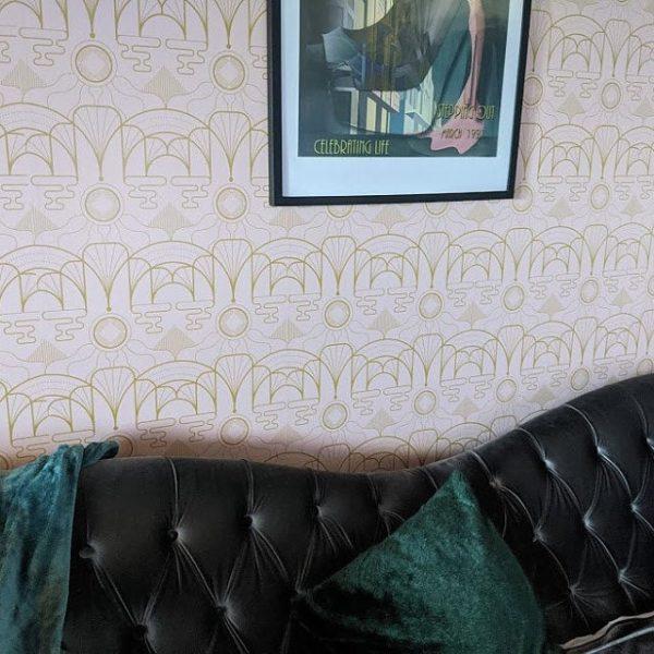 Pink art déco wallpaper in cozy living room