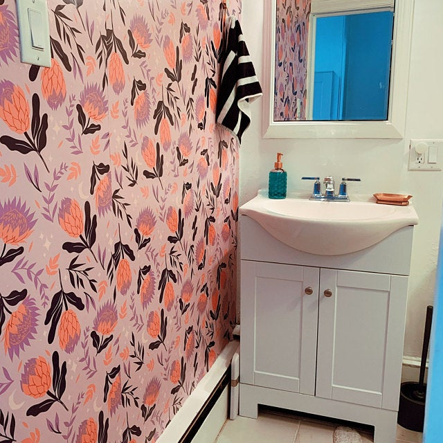 Pink floral peel and stick wallpaper on wall