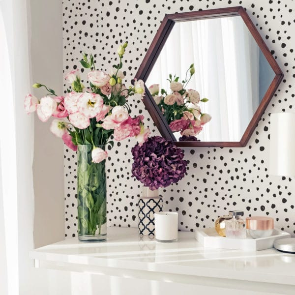 black scattered polka dot peel and stick wallpaper
